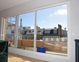 Super baie vitrée ensoleillée à Paris